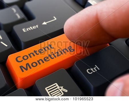 Content Monetizing Concept. Person Click Keyboard Button.
