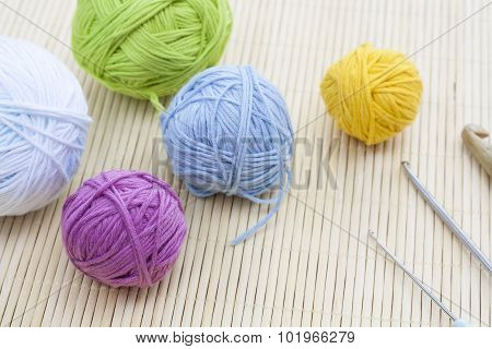 Color woolen clews for knitting close-up, selective focus
