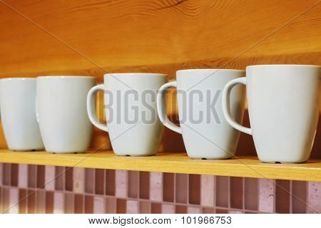 Clean cups are on the shelf