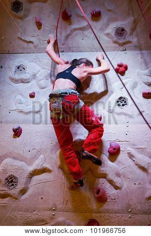 COLOGNE, GERMANY- SEPTEMBER 19, 2014: woman climbing pending The Photokina Exhibition. The Photokina is the world's largest trade fair for the photographic and imaging industries