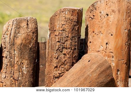 Close up of a wooden logs fence