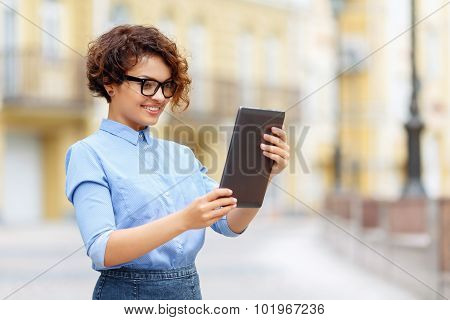 Pleasant girl holding laptop