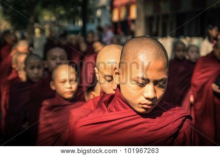 Young Buddhist Monk Novice Walk To Collect Alms And Offerings In Amarapura Myanmar