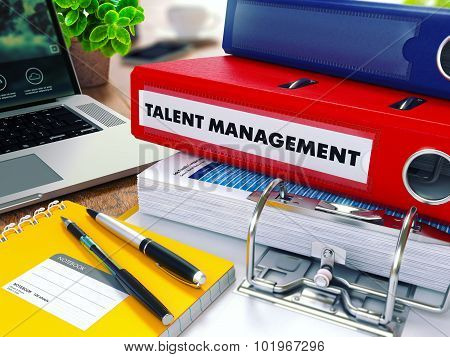 Talent Management on Red Ring Binder. Blurred, Toned Image.
