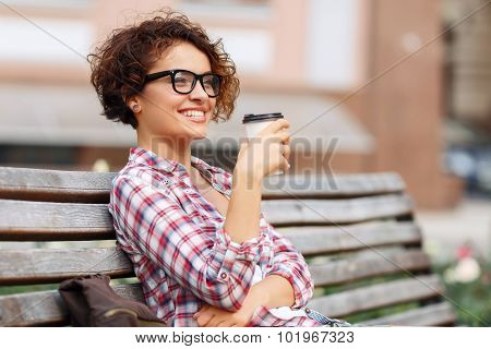 Nice girl sitting on the bench
