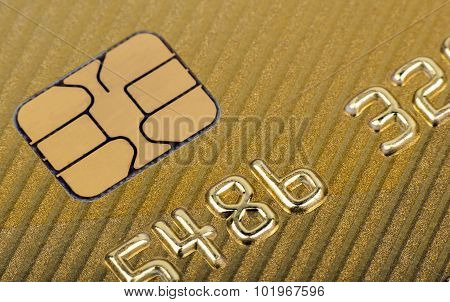 Chip of gold plastic credit card.