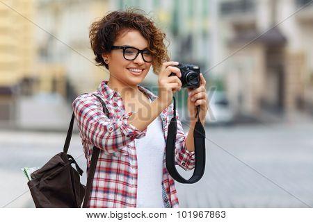 Nice girl holding photo camera