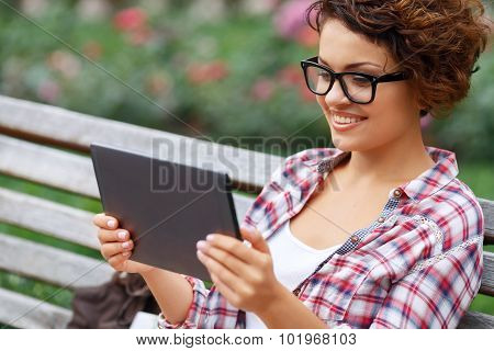 Positive girl resting on the bench
