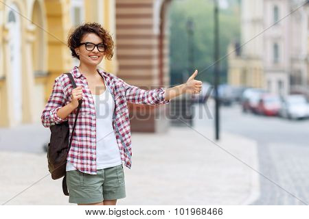 Nice girl standing in the street