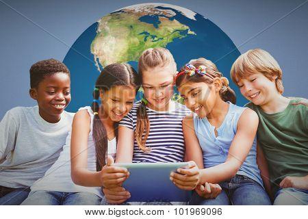 Children using digital tablet at park against blue background