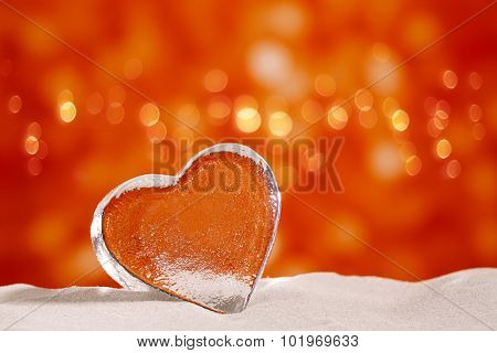 clear glass heart on white sand beach  glitter glass  and reflection ,  sky and seascape