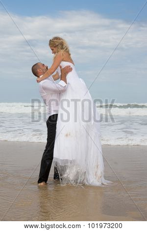 Newly Wedding Couple At The Beach In Love