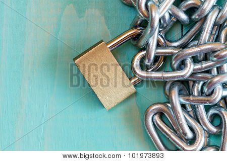 Padlock On The Blue Wooden Background