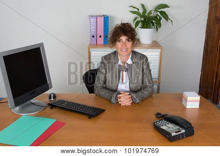 Very Lovely Middle Age Business Woman At Office
