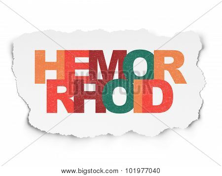 Healthcare concept: Hemorrhoid on Torn Paper background