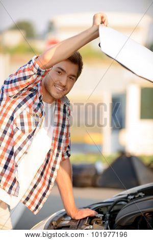 Nice boy opening bonnet