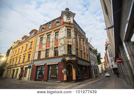 RIGA, LATVIA - SEN 13, 2015: One of the streets in the medieval town of old Riga. Riga has long been a Hanseatic city, there are buildings of different styles from medieval to modern architecture.