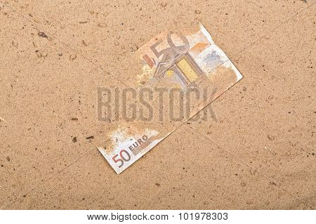 Euro in the sand