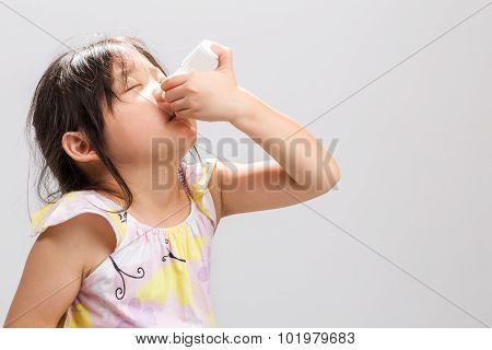 Kid Using Nasal Spray Background / Kid Using Nasal Spray / Kid Using Nasal Spray, Studio Isolated Ba