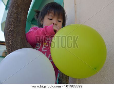 Child Plays With Balloons (1)