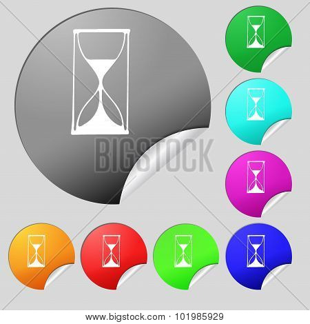 Hourglass Sign Icon. Sand Timer Symbol. Set Of Eight Multi Colored Round Buttons, Stickers. Vector