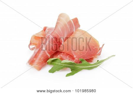 slice of prosciutto or jamon with arugula leaf