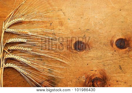 Vintage wood table with spikelets of wheat