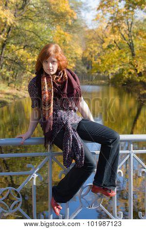 Girl On The Railing Of The Bridge
