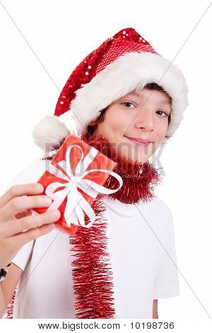 Cute Christmas Boy With A Red Gift Isolated On White Background, Studio Shot.