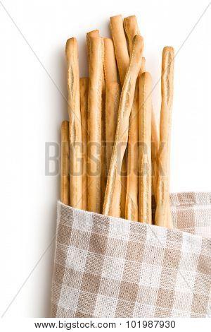 breadsticks grissini on white background