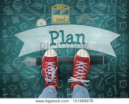 The word plan and casual shoes against green chalkboard