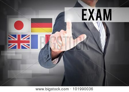 The word exam and businessman pointing with his finger against abstract white room