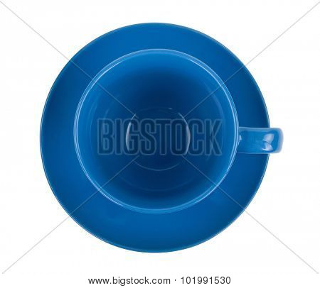 Blue round empty tea cup on a saucer