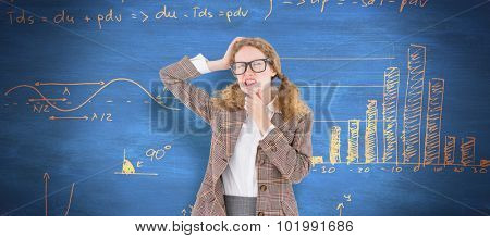 Geeky hipster thinking with hands on chin and temple against blue chalkboard
