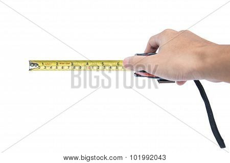 Hand holding nylon measurement tape, selective focus