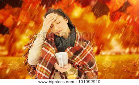 Sick woman having a migraine against park