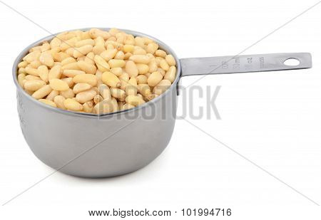 Pine Nuts In A Measuring Cup