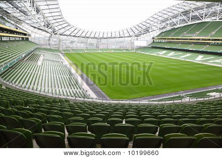 Rows of green seats in an empty stadium Aviva.