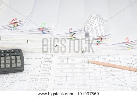 Pencil And Calculator Have House On Step Pile Of Paperwork