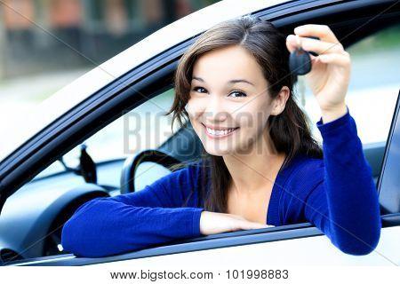 Cute girl shows a car key