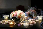 stock photo of flower arrangement  - a bouquet of flowers with candles taken during a wedding event - JPG