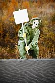 stock photo of scoria  - Scientist in protective suit and gas mask carry poster - JPG