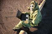 pic of scoria  - The scientist works with a laptop in a zone of ecological disaster - JPG
