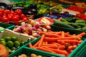image of farmers market vegetables  - fresh assorted vegetables in boxes on farmer - JPG
