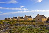 pic of slave-house  - Historical yellow slave huts on Bonaire Caribbean - JPG