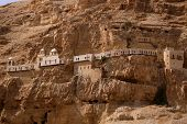 stock photo of jericho  - Looking up at the Monastery set in the Mount of Temptation in Jericho - JPG