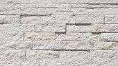 stock photo of fieldstone-wall  - Texture of a light limestone masonry wall with horizontal strips of split face rock - JPG