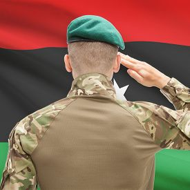 foto of libya  - Soldier in hat facing national flag series  - JPG