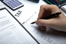 stock photo of scat  - office work and filling in tax returns close up - JPG