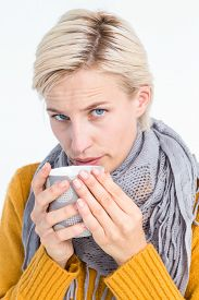 stock photo of feeling better  - Close up of woman drinking from a cup to feel better - JPG